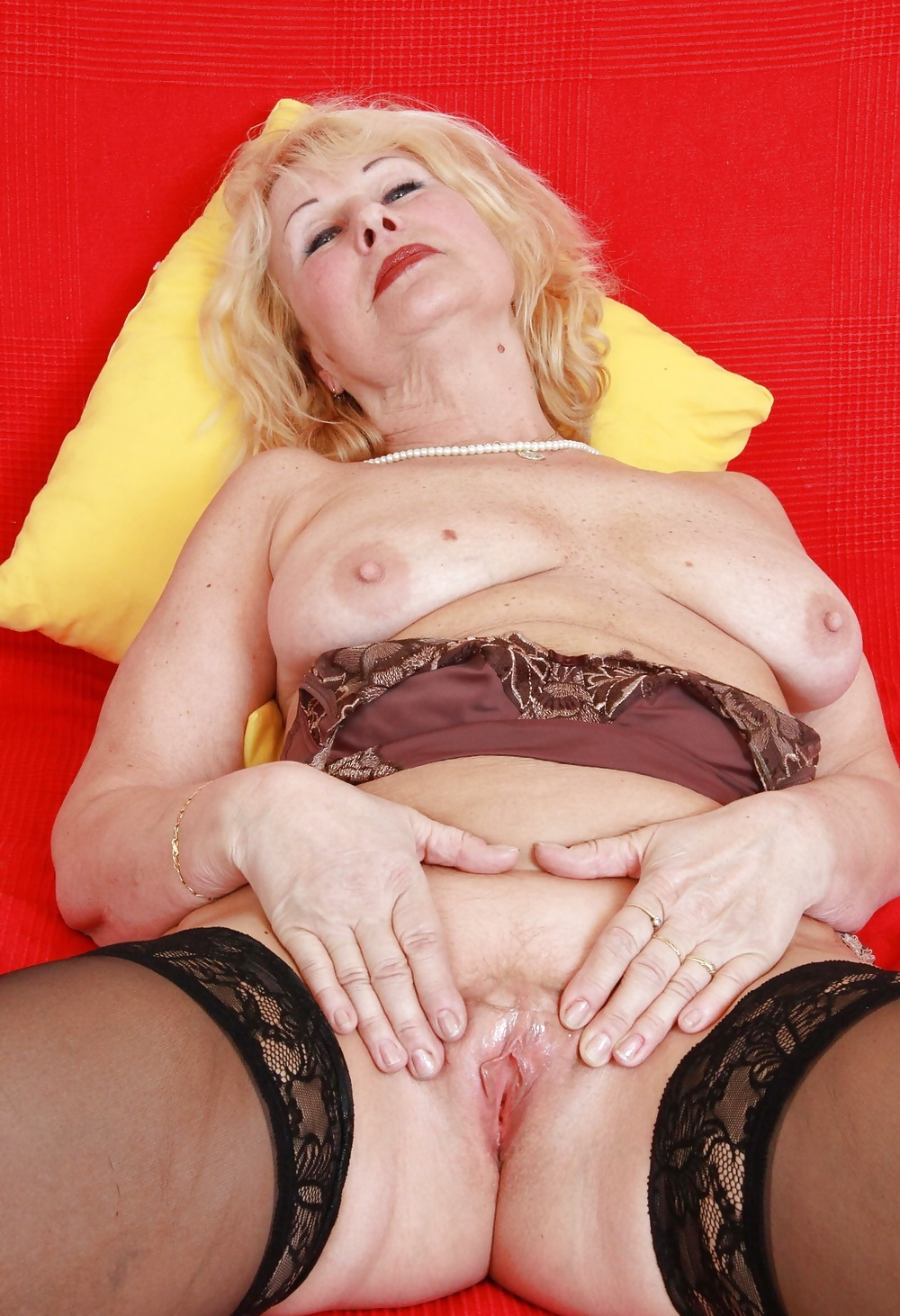 Kinky Granny Punishes Mature Babe With A Strap
