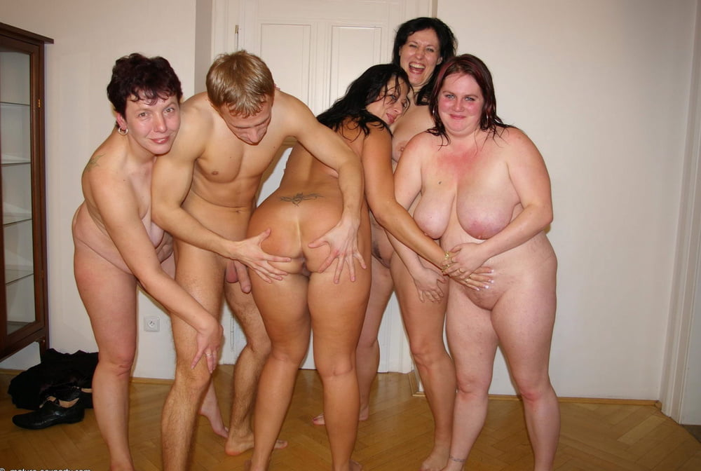 Mature women don strapons after getting naked for lesbian group sex