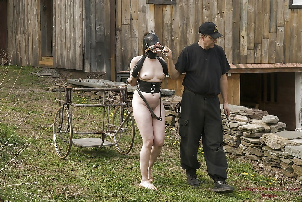 nude-woman-in-bondage-in-farm-seductive-amateur-redhead