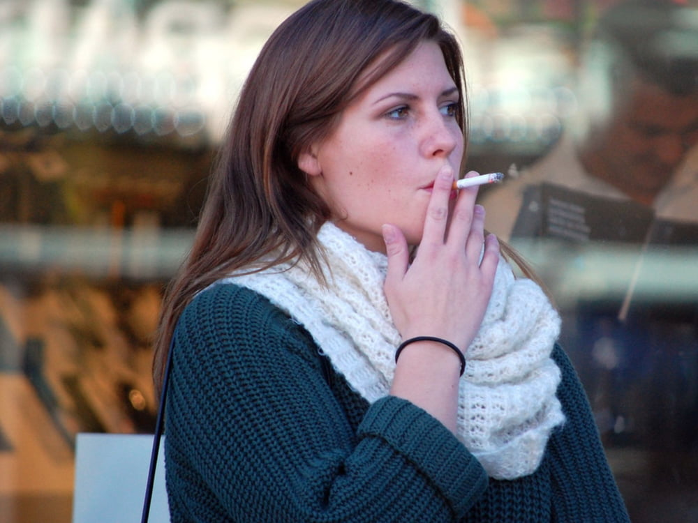 Mature Woman Smoking Cigarette In Park