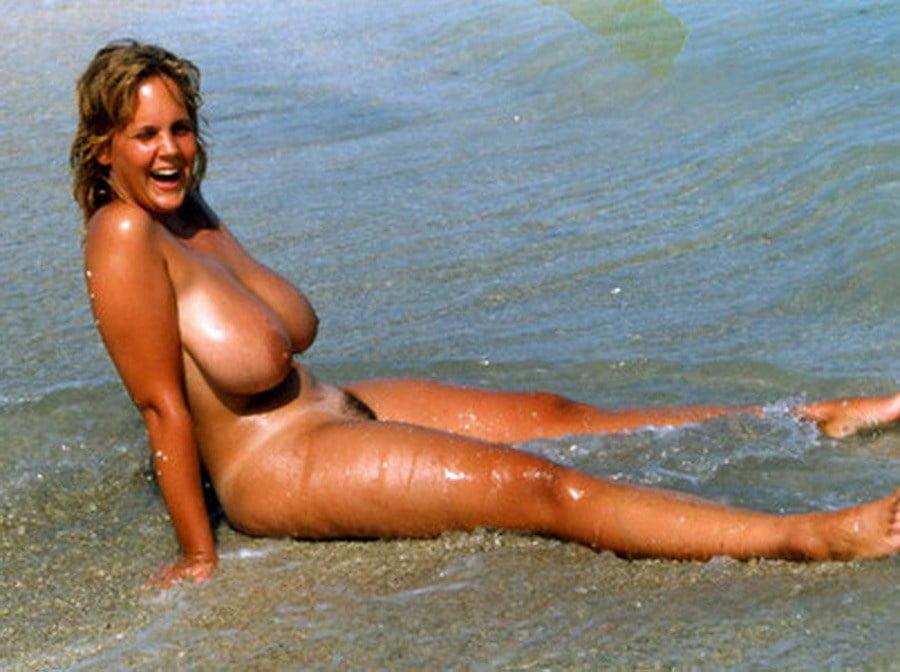 Redhead mature beach boobs