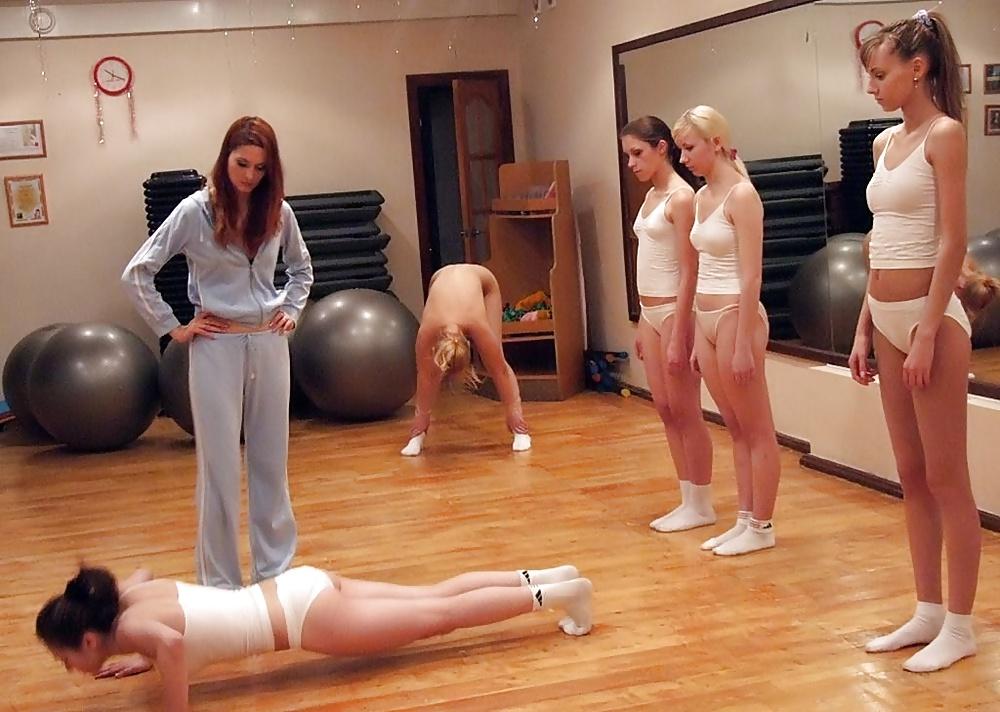 Naked teen girl doing sport exercises