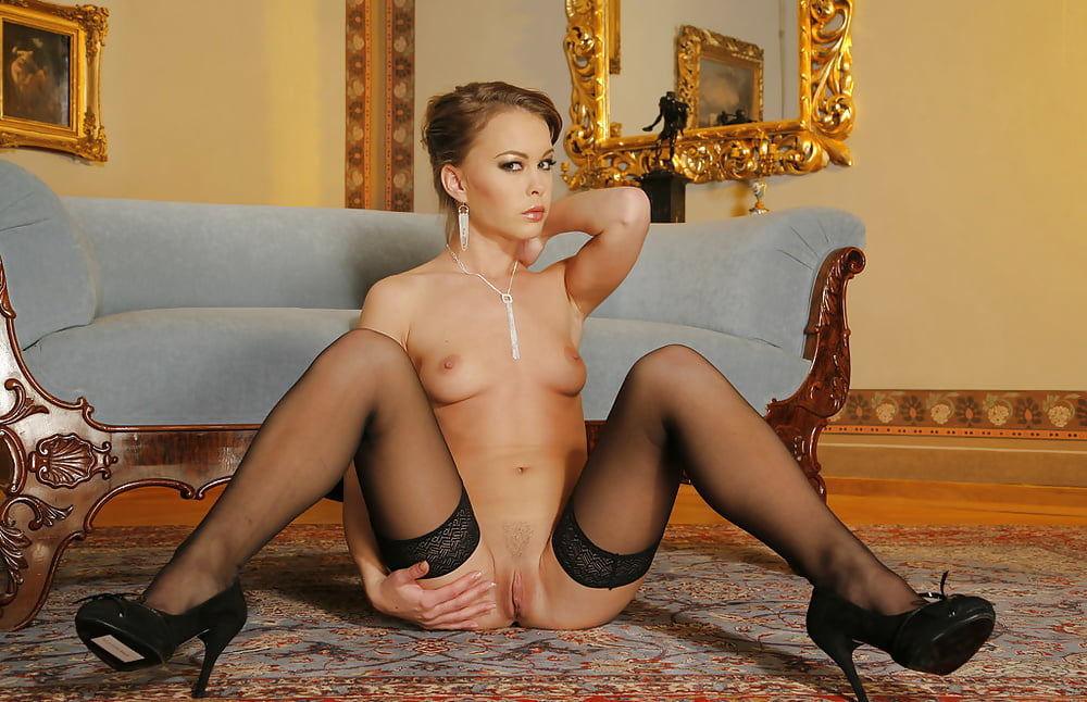 An incredibly beautiful woman with big natural tits makes love