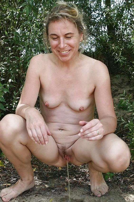 Big titted mature naked woman pissing