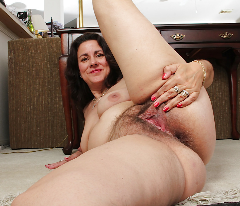Milf has a very wet hairy pussy for us to see