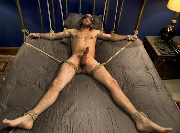 Naked guys tied to bed