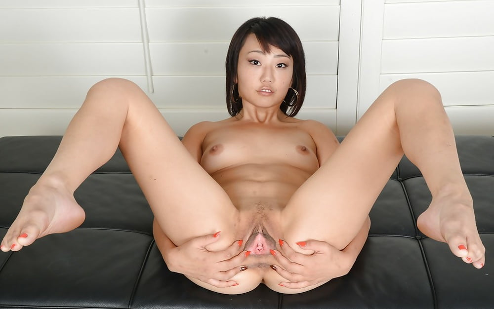 She is a fine asian girl in the nude and the high heels make her ass tight