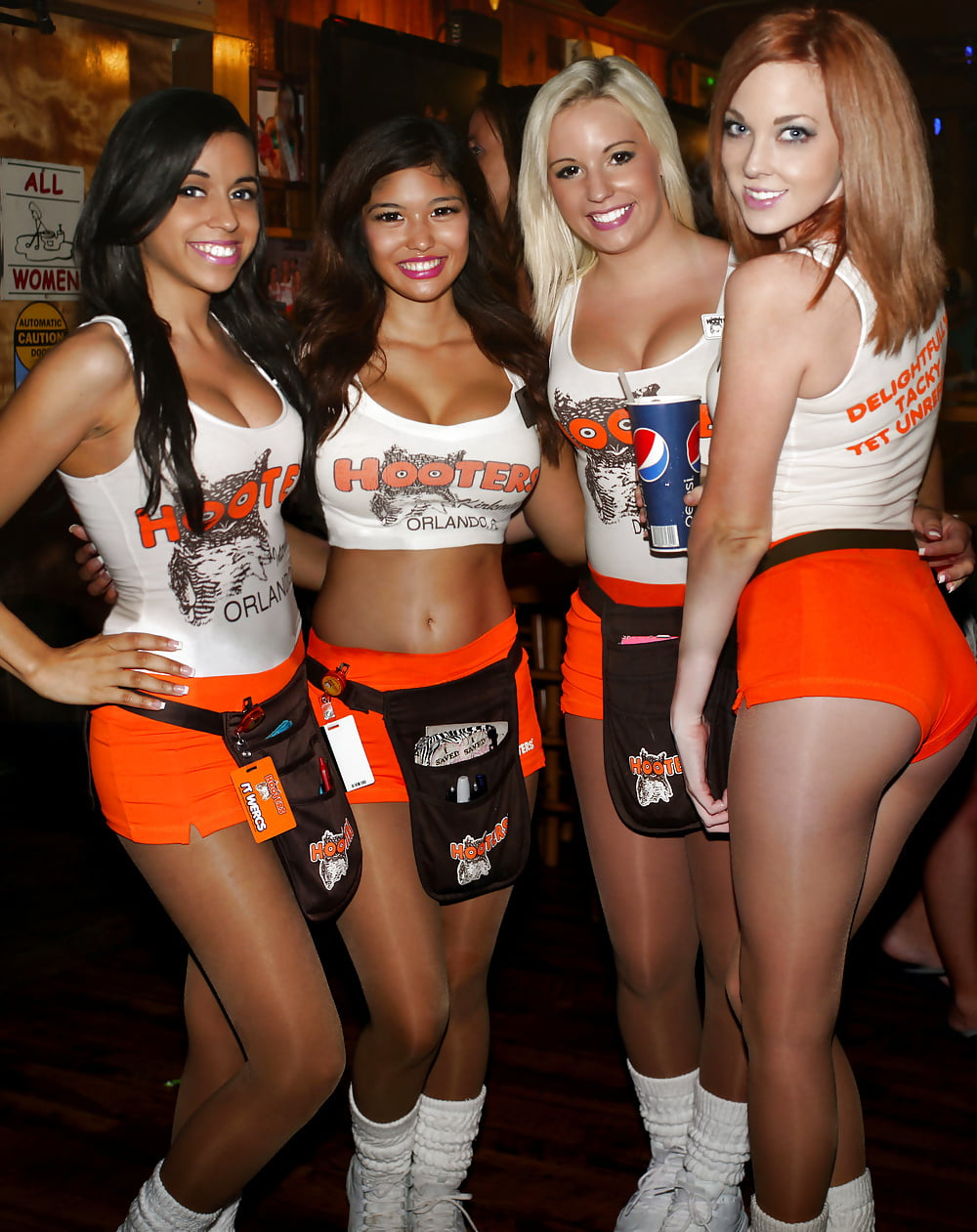 Sexy hooters girl with glasses wearing hot pants