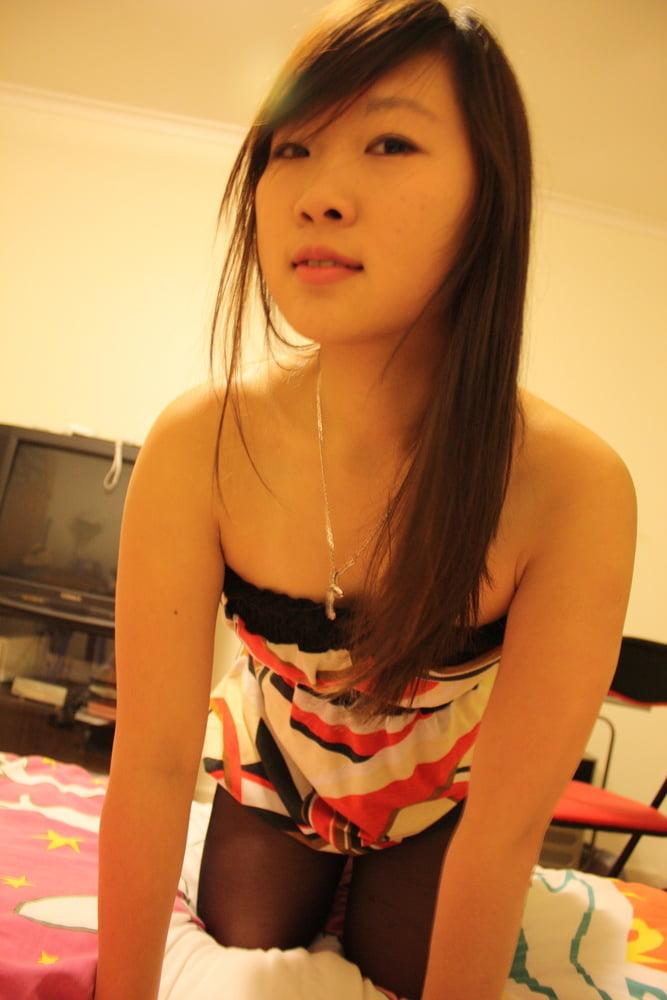 Asian Milf strip for photographer - 27 Pics