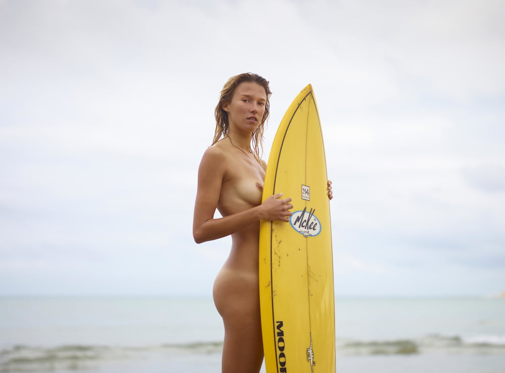 Slim Blonde Bitch Takes Off Her Clothes And Poses Naked On The Beach