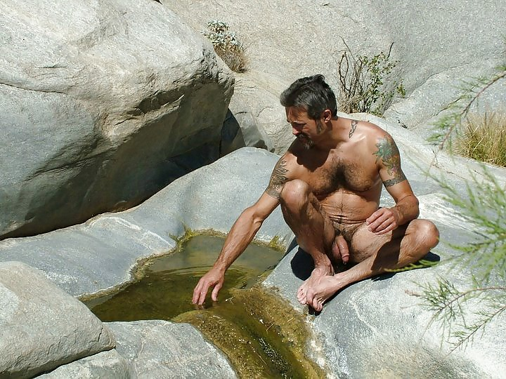 Nude guy with a flaccid uncut penis