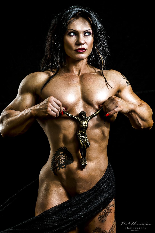 Sexy bodybuilder muscular torso exercising dumbbell stock photo