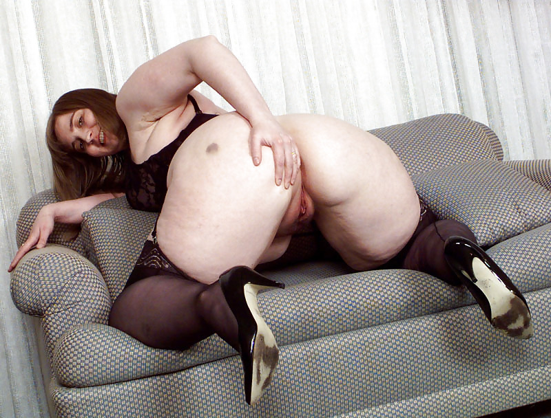 Shows off pussy