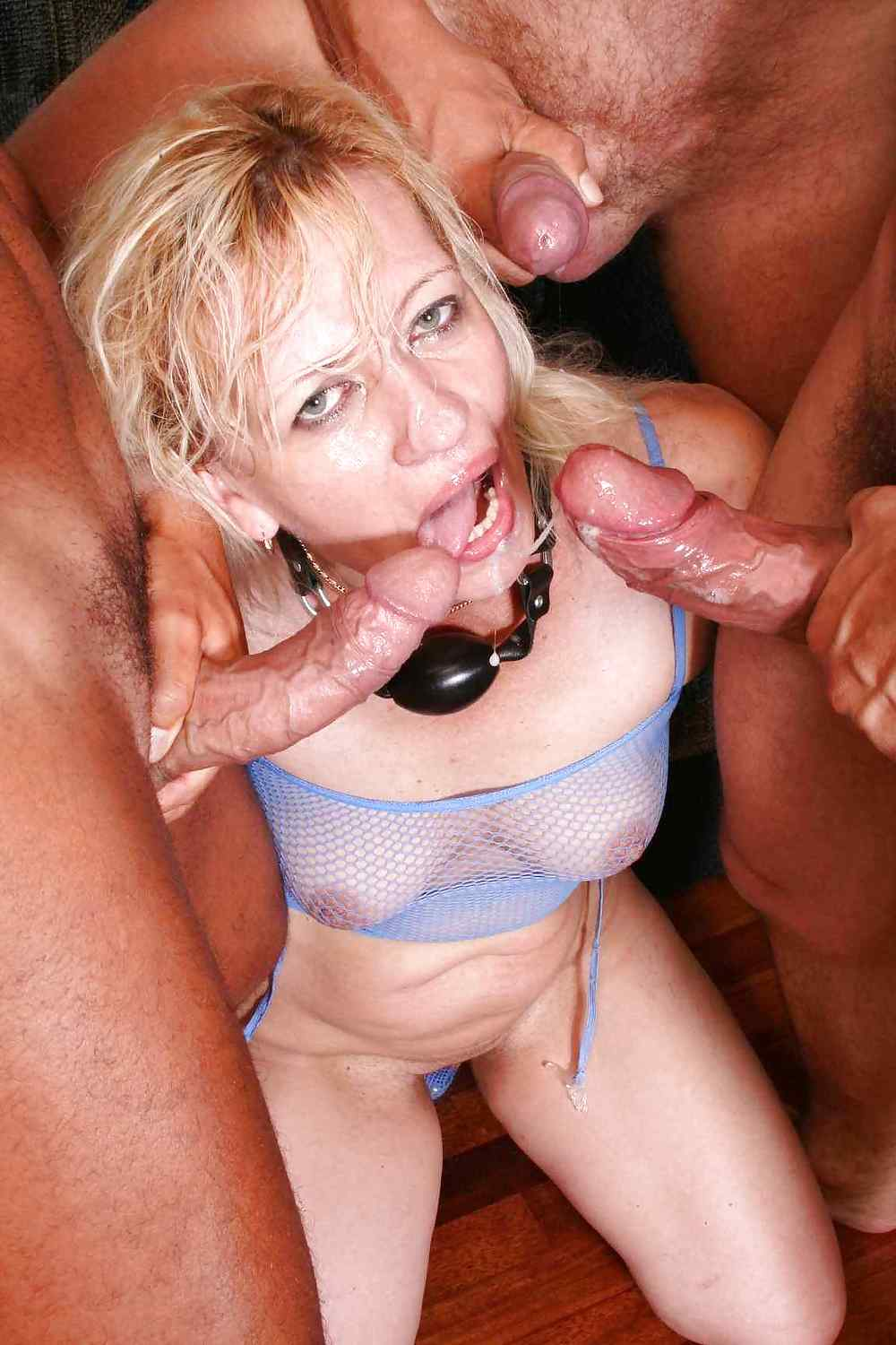 Sexy mature blonde spreads her pussy and ass with bangers