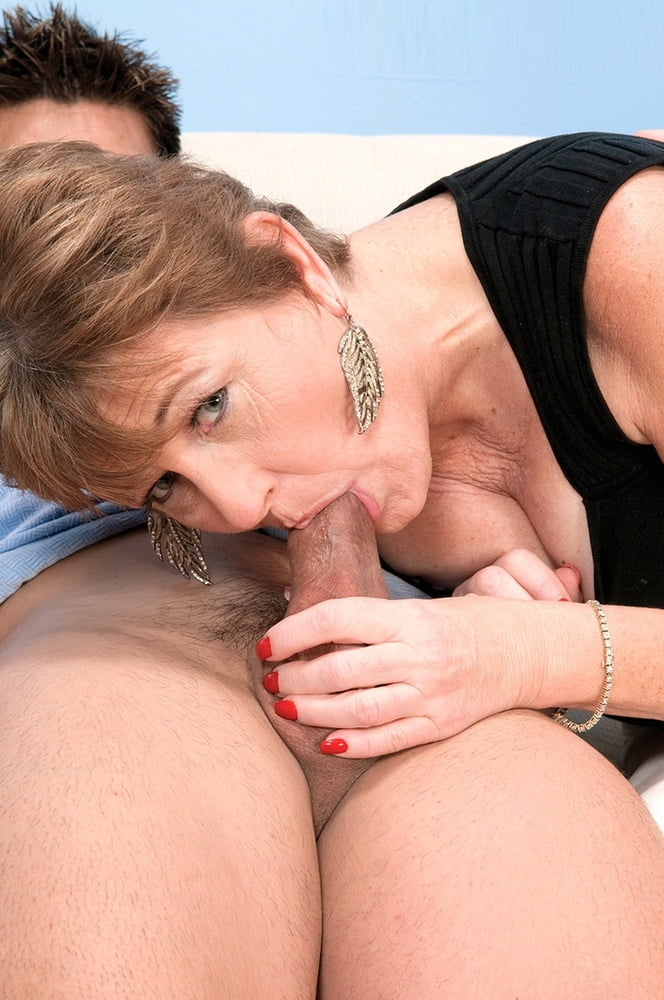 Short haired cougar sucking cock and balls