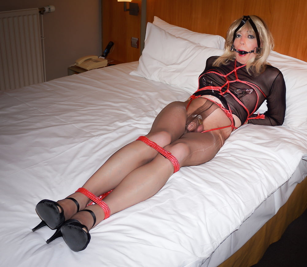 Busty tied up gal fucked by busty tranny