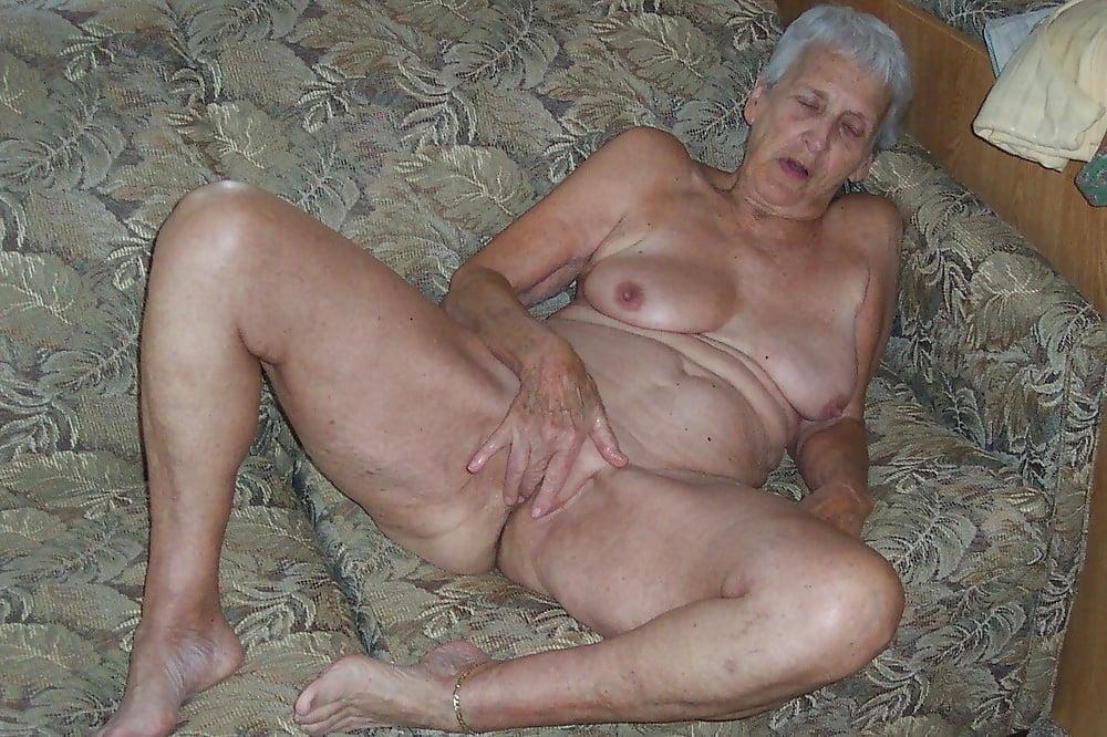 Happy mature granny and small granddaughter have fun