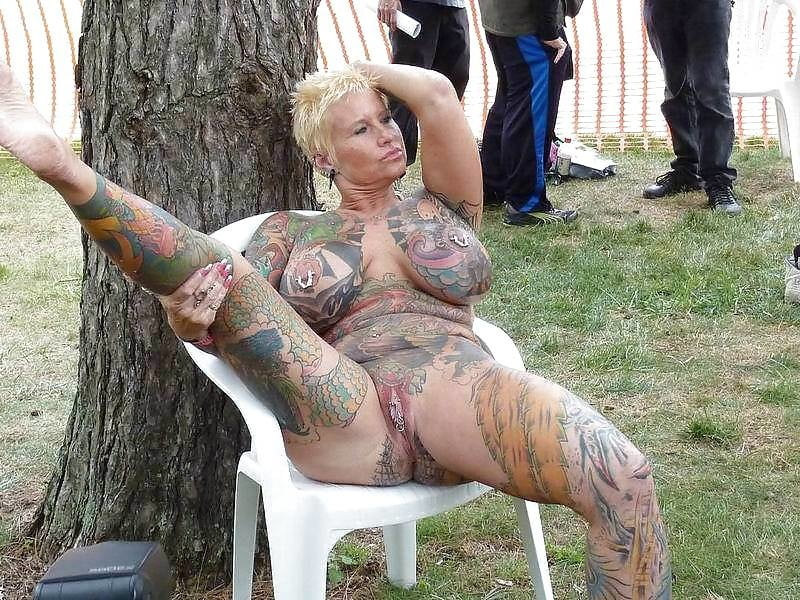 Tattooed mature woman high resolution stock photography and images