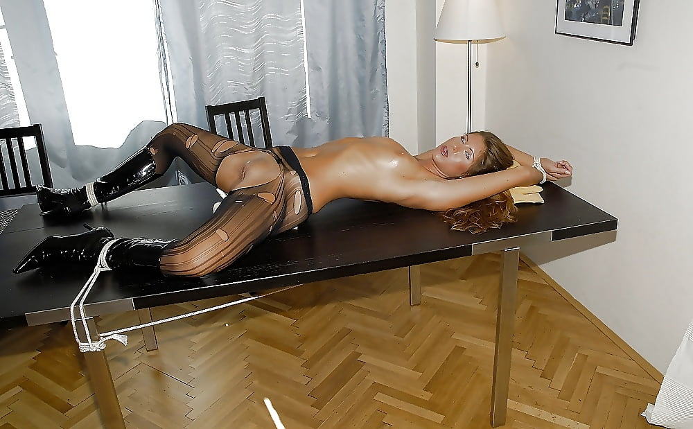 slutload-pantyhose-tied-to-a-table