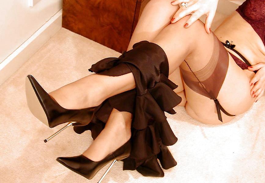 Classy elegant lady removes formal wear