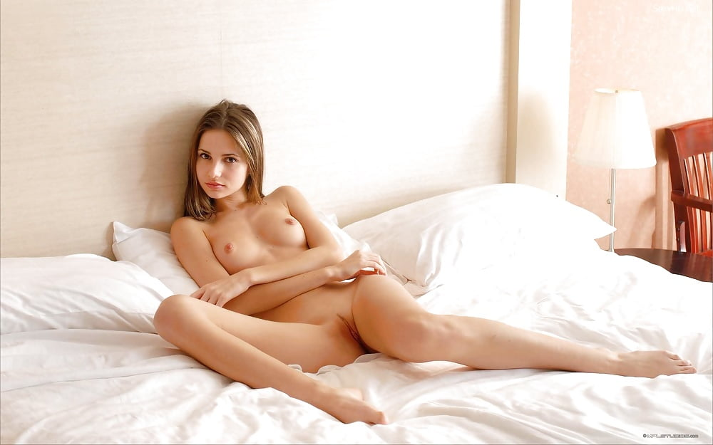 Teenage girl naked in bed