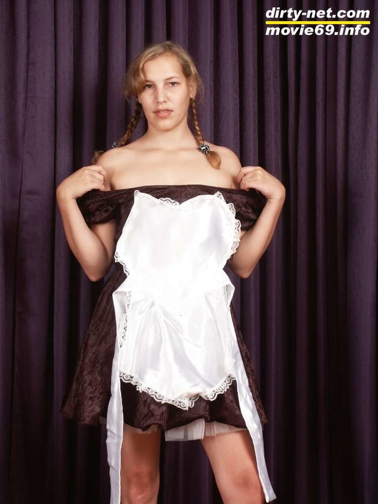 Teen Nathalie poses as a maid and strips - 20 Pics