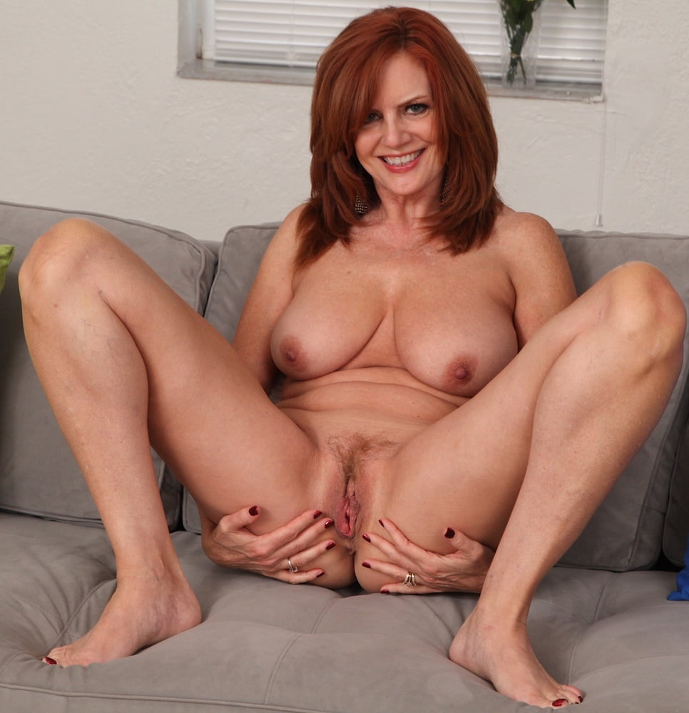 Naked redhead cougar showing pink