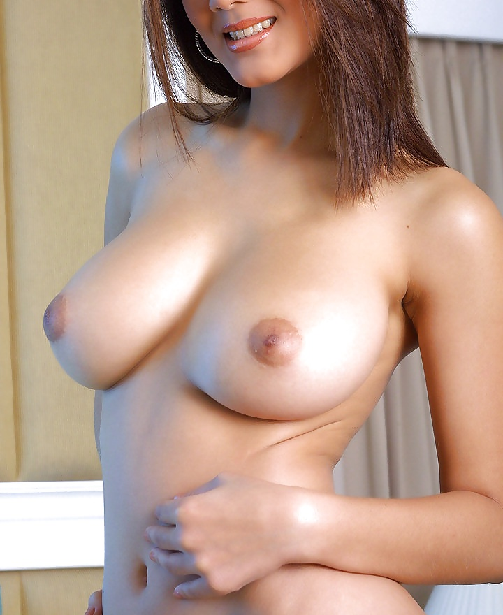 Thai woman with tight body and big tits performs with her self