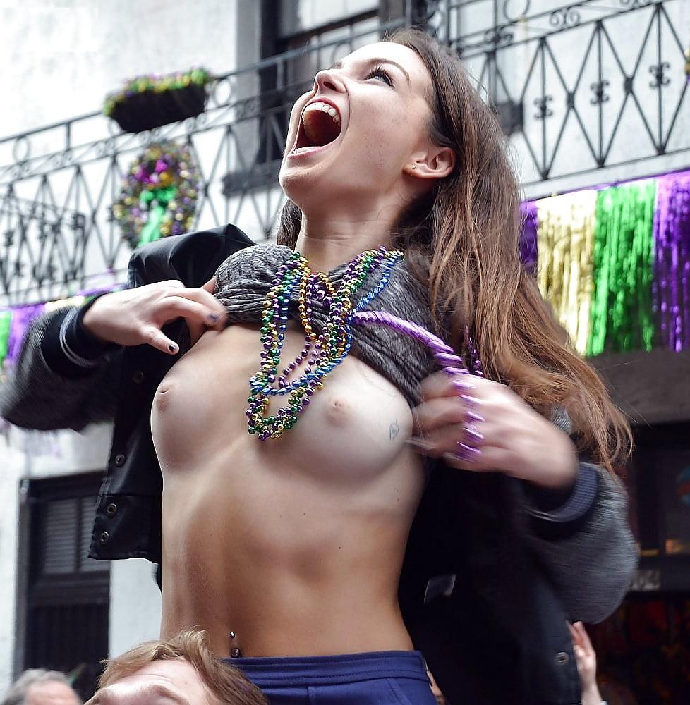 Mardi gras girls flashing their boobs