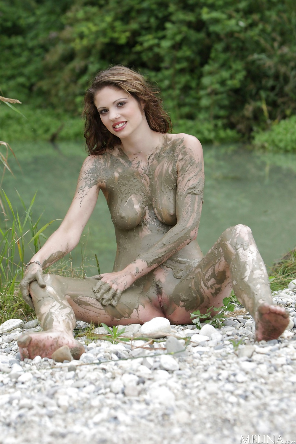 Nude girls in the mud
