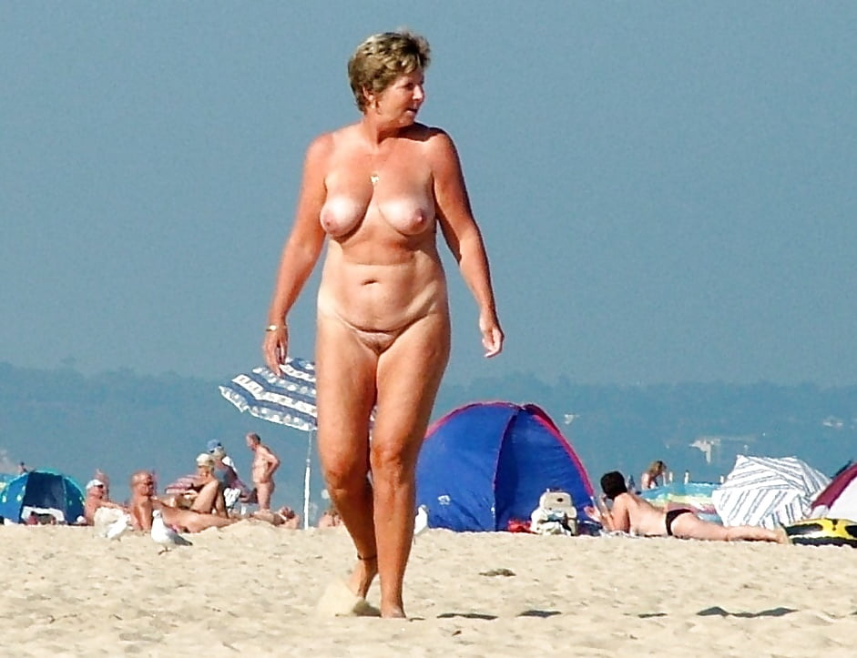 Old person at nudist beach — pic 2
