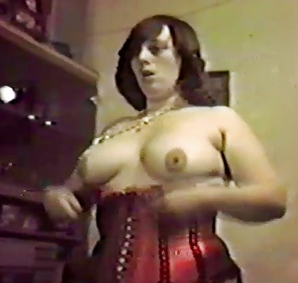 video stills of heather in out of her red basque
