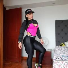 Muscular MILF In Pink