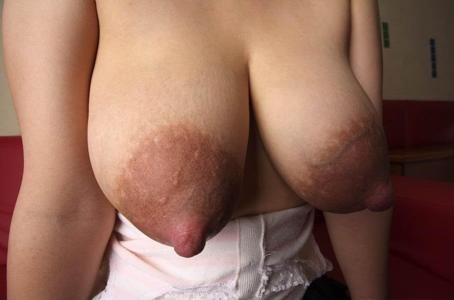 Nina plays with her gigantic milky floppy tits engorgedtits