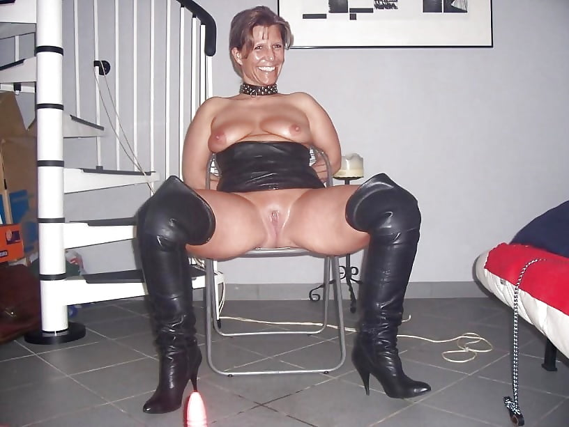 Horny milf with amazing tits in white boots