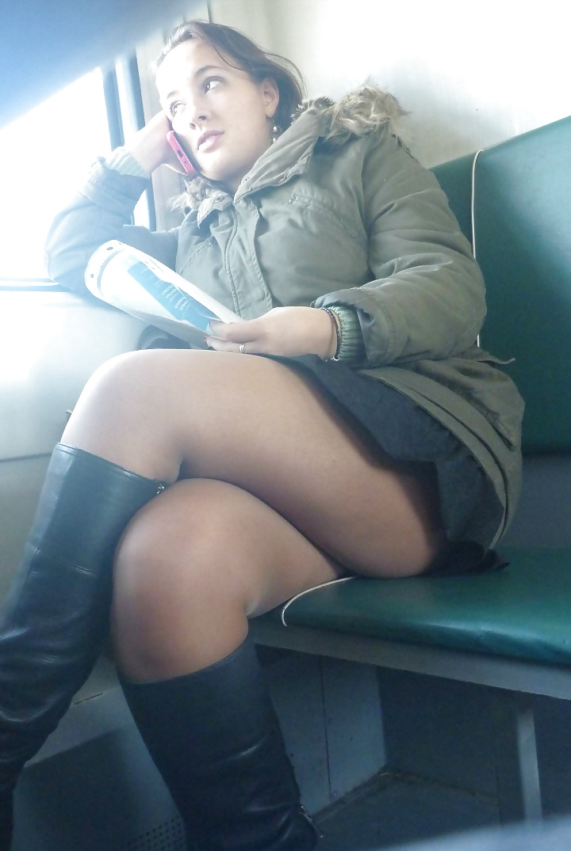 See and Save As sitting upskirt in train en legs en