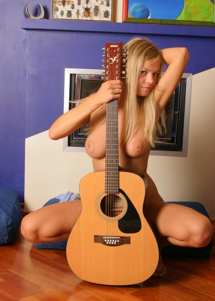 Nude women with guitars