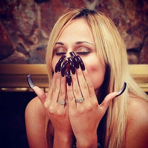 Blonde girl with long fingernail #4