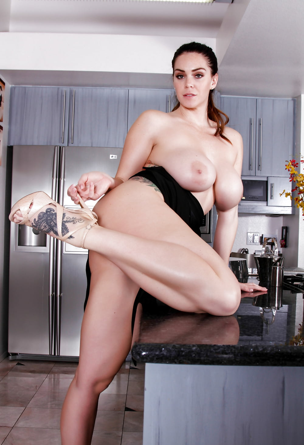 Alison tyler uses her long legs to tease off her stockings