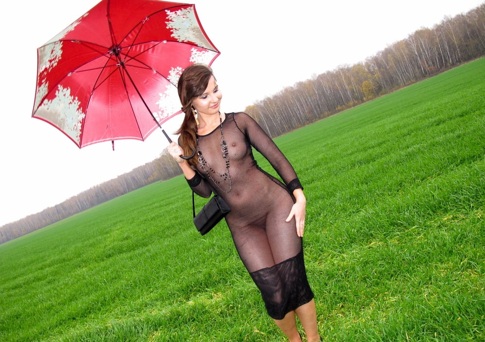 Naked women with umbrellas