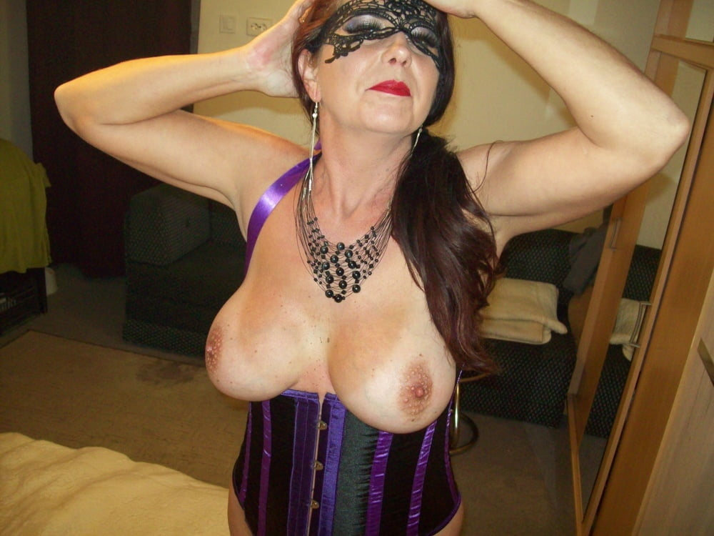 Wildcat in purple corset - 105 Pics