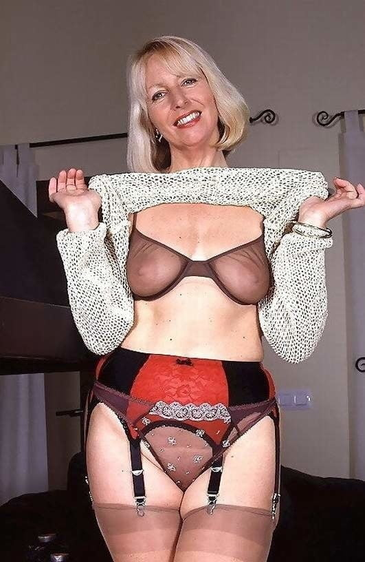Mature in tight bra