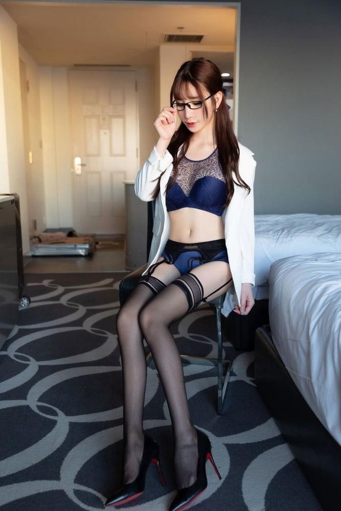 Asian girl spreading