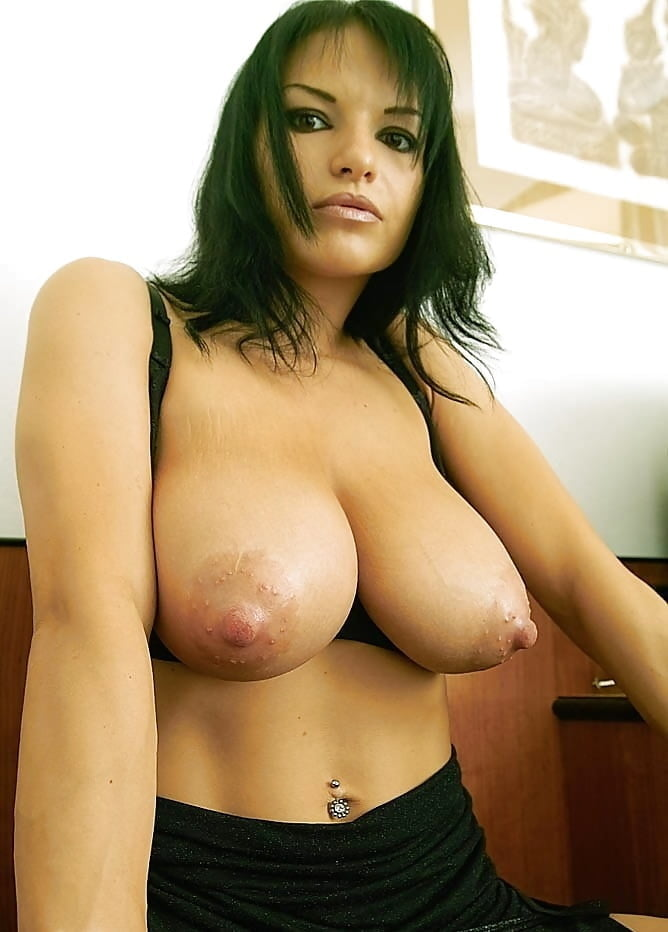 Busty dark haired lady toys on cam