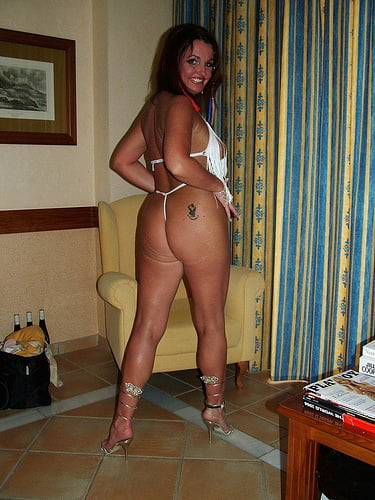 Sexy milf shows her lingerie and high heels- 136