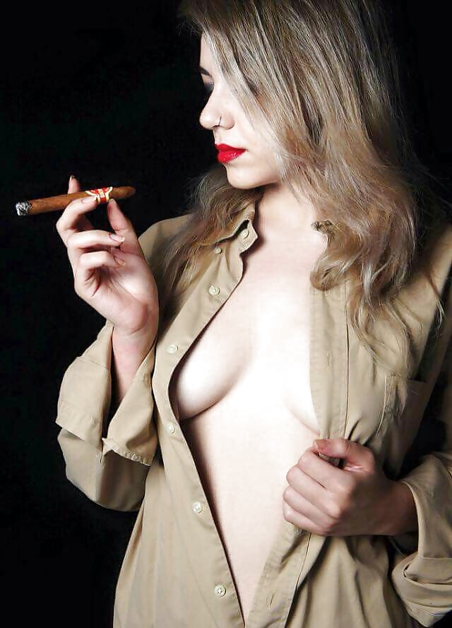 Skinny naked girl smokes cigar