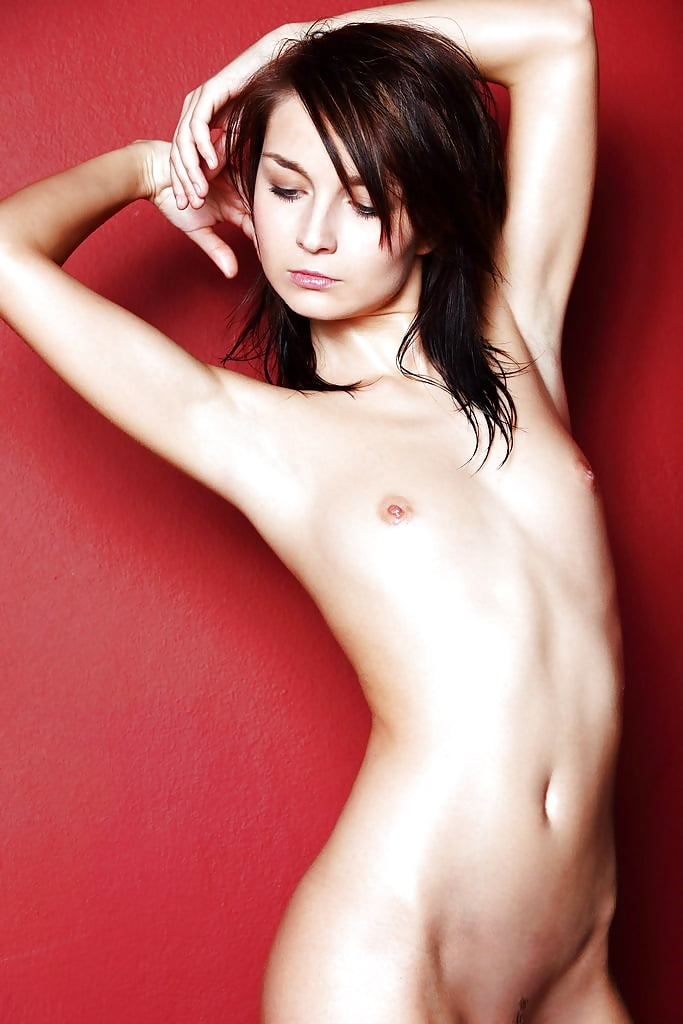 Young girl with beautiful naked body closes her hand chest close