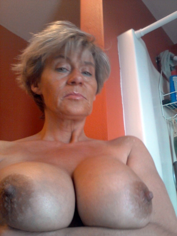 Mature big tits drinking