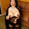 Hot black-haired mature with big tits