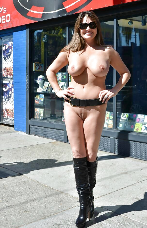 Busty milf pics on the street turning heads letting it all hang out